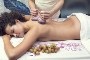 Thai massage bags and grapes in a beauty salon
